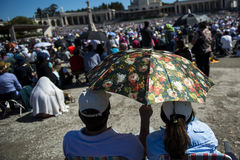 Crowd of people at the Sanctuary of Fatima during the celebrations of the apparition of the Virgin Mary in Fatima, Portugal. Fatima, Portugal - May 13, 2014 Stock Photography