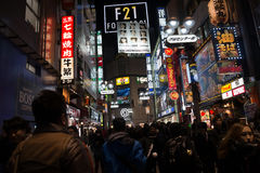 Crowd people in Shibuya at night in Tokyo,Japan Stock Photos