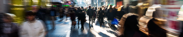 Crowd of people on shopping street. With creative camera made zoom effect Royalty Free Stock Image