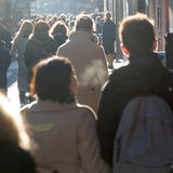 Crowd of people on a shopping street. Silhouettes of a crowd of people on a shopping street Royalty Free Stock Photo