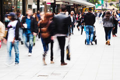 Crowd of people on the shopping street. Crowd of people walking on the shopping street in motion blur Stock Image