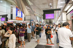 Crowd of people in Singapore subway waiting for the train. Royalty Free Stock Image