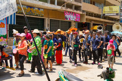 Crowd of people in Songkran festival. NAKHON SAWAN - APRIL 13 : Crowd of Thai people dancing and throwing water during the Songkran New Year Festival, April 13 Royalty Free Stock Images