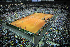 Crowd of people in sports court during a tennis match Stock Photo