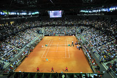 Crowd of people in sports court during a tennis match Stock Photography