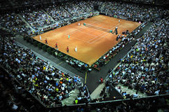 Crowd of people in sports court during a tennis match Royalty Free Stock Image