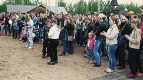 Crowd people stay on sand in park. Audience. Summer festival. Applaud. Children stock video
