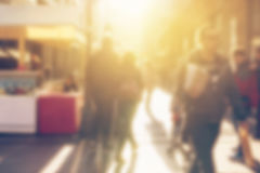 Crowd of people on the street, blur defocussed image Royalty Free Stock Photography