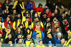 Crowd of people, supporters in a stadium during a football match Royalty Free Stock Image
