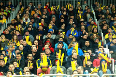 Crowd of people, supporters in a stadium during a football match Stock Photo
