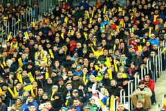 Crowd of people, supporters in a stadium during a football match Royalty Free Stock Photography