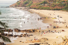 Crowd of people swimming and chilling on beautiful ocean beach Royalty Free Stock Image