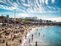 Crowd of people swimming and sunbathing Royalty Free Stock Image