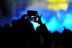 Crowd of people taking photos with smartphones at a concert Royalty Free Stock Photography