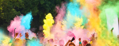 Crowd of people throwing colored powder. Crowd of people on color run throwing colored powder Stock Images