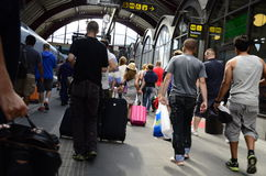 Crowd of people at a train station. A crowd of people at a train station in Sweden. People are walking along the track after departing from the train royalty free stock photography