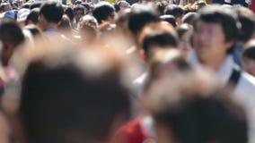 Crowd people, traveler walk on street side to subway in Tokyo, Japan. TOKYO JAPAN - NOVEMBER 4, 2015: Urban life- Crowd of people, tourist, traveler walk on stock video