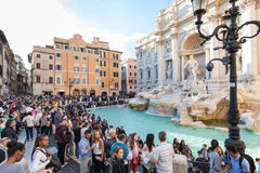Crowd of people and Trevi Fountain in Rome city Stock Photos