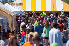Crowd Of People Walk Around At Festival Royalty Free Stock Photos
