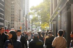 Crowd of people walking along the famous fifth avenue Royalty Free Stock Photos