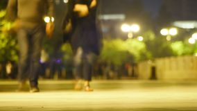 Crowd of People is Walking Along the Night Street. Timelapse. AZERBAIJAN, BAKU, MAY 9, 2017: Crowd of People is Walking Along the Night Street. Timelapse stock footage