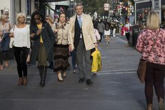 A crowd of people are walking along Oxford Street. stock image