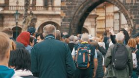 Crowd of People walking along the urban street of the old city in Prague, Czech Republic. Slow Motion stock video footage