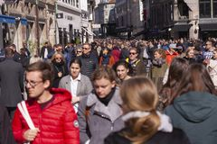 Crowd of people walking in a busy street. Stock image stock image