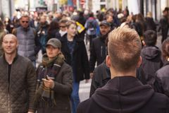 Crowd of people walking in busy street. Stock image stock image