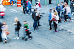 Crowd of people walking in the city Stock Photos