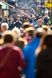Crowd of people walking on city street stock images