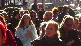 Crowd of people walking through Fifth Avenue USA cityscapes stock footage