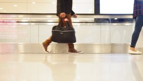 Crowd of people walking with luggage in the international airport, close up shot of legs and shoes stock video