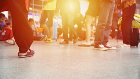 Crowd of people walking with luggage and many people sitting in the bus terminal, de-focused scene.  stock footage
