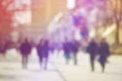 Crowd of People Walking On the Street in Bokeh Royalty Free Stock Images