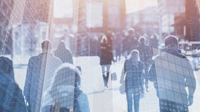 Crowd of people walking on the street, double exposure. Abstract business background royalty free stock photography