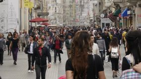 Crowd of people walking in the street Istiklal Street. ISTANBUL - CIRCA MAY 2016: crowd of people walking in the street Istiklal Street, Taksim, Istanbul, May stock video