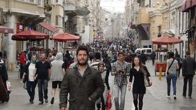 Crowd of people walking in the street Istiklal Street. Taksim, Istanbul stock footage