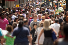 Crowd of people walking on street sidewalk stock images