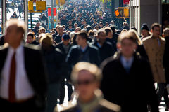 Crowd of people walking on street sidewalk royalty free stock image