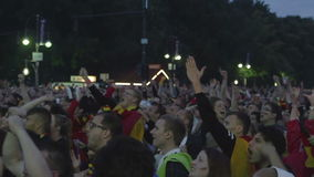 Crowd of people watching football stock footage