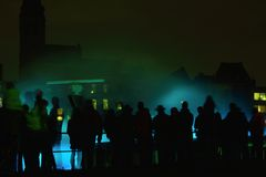 Crowd of people watching hologram water-light show. BELGIUM, GHENT, 31 JANUARY 2015: Unidentified crowd of people watching hologram water-light show in the Royalty Free Stock Photos