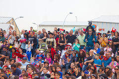 Crowd of people watching Purim performace Stock Photo