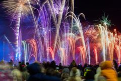Crowd of people are watching to fireworks. Celebration of Latvia 100th anniversary. 18.11.2018. RIGA, LATVIA. Staro Riga festival of light and Fireworks, light royalty free stock photos