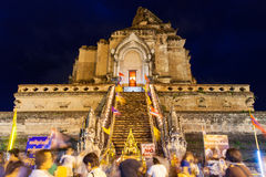 Crowd of people worshiping at Wat Chedi Luang during City Pillar Festival Stock Photos