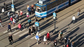 Crowd of people on zebra crossing in Tallin,