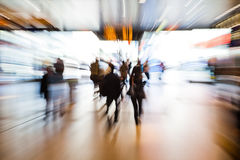 Crowd of people with zoom effect. Crowd of people in a shopping passage of a railway station with zoom effect Royalty Free Stock Images