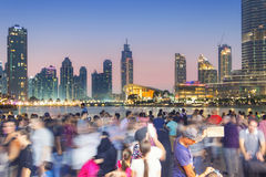 Crowd photographs the Dubai skyline