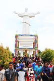 Crowd of pilgrims by memorial on Mansinam island - Jesus royalty free stock image