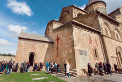 Crowd of praying men and women around the walls of Svetitskhoveli Cathedral. UNESCO World Heritage Site. Royalty Free Stock Photography